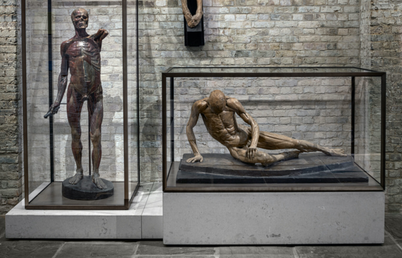 """Goppion """"A -Class"""" museum display cases holding religious sculptures"""